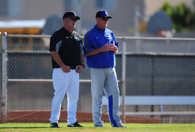 Silverado head coach Brian Whitaker, left, talks with Basic head coach Scott Baker in the fourth inning of their prep baseball game at Silverado High School in Henderson Wednesday, April 13, 2016. ...