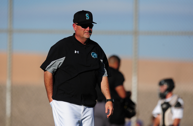 Silverado head coach Brian Whitaker walks to the dugout after making a pitching change in the sixth inning of their prep baseball game against Basic at Silverado High School in Henderson Wednesday ...