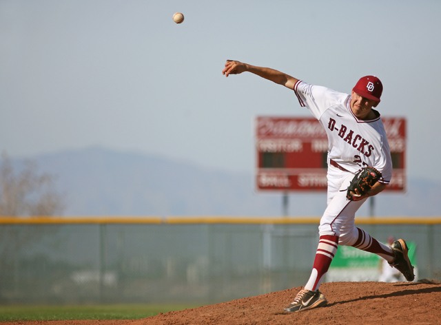 Desert Oasis senior Nolan Kingham pitches during the third inning of a game against Cimarron-Memorial at Desert Oasis High School Monday, March 23, 2015, in Las Vegas. Kingham has committed to pla ...