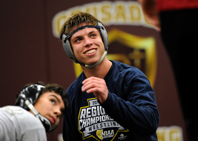 Faith Lutheran wrestler Owen Lawrie, left, smiles during a short break while grappling with teammate Hale Enos during practic. Lawrie is looking to become the first back-to-back state wrestling ch ...