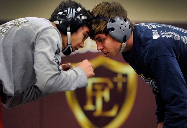 Faith Lutheran wrestler Owen Lawrie, right, goes head-to-head with teammate Hale Enos during practice. Lawrieis looking to become the first back-to-back state wrestling champ in school history. (D ...