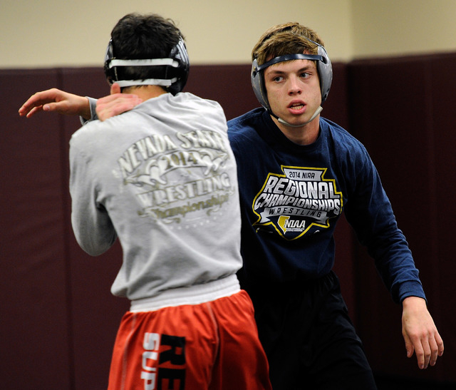 Faith Lutheran wrestler Owen Lawrie, right, grapples with teammate Hale Enos during practic. Lawrie is looking to become the first back-to-back state wrestling champ in school history. (David Beck ...