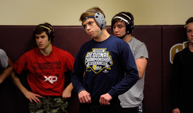 Faith Lutheran wrestler Owen Lawrie, center, looks on during practice. The senior is looking to become the first back-to-back state wrestling champ in school history. (David Becker/Las Vegas Revie ...