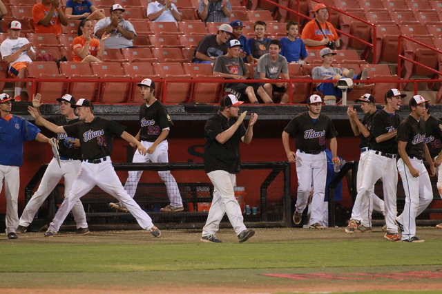 Bishop Gorman players and staff celebrate while playing against Rancho during the American Legion state baseball tournament on Saturday. Rancho rallied for a 9-8 victory to capture the state champ ...