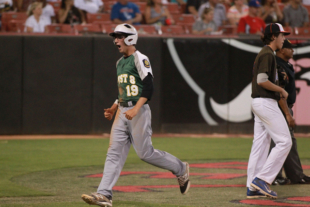 Rancho player Richard Coughlin (19) celebrates after scoring a run against Bishop Gorman during the American Legion state baseball tournament on Saturday. Rancho rallied for a 9-8 win to take the  ...