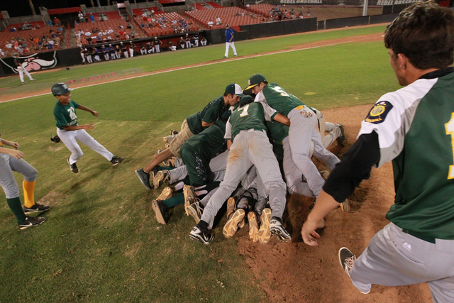 Rancho players celebrate after defeating the Las Vegas Titans 9-8 to win the American Legion state baseball tournament. (Chase Stevens/Las Vegas Review-Journal)