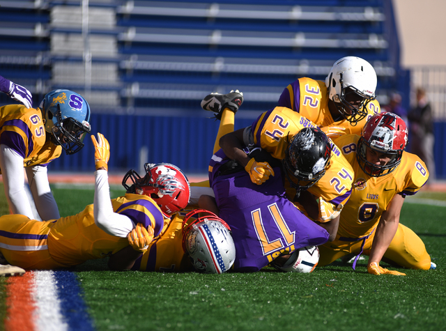The Sunrise Region defense sacks Sunset quarterback Christian Tasi (17) during the Lions Club  All-Star Football game Saturday at Bishop Gorman. The Sunrise Region won 41-0. (Martin S. Fuentes/Las ...