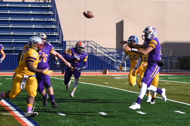 Sunset Region quarterback Christian Tasi (17) throws a pass against the Sunrise Region during the Lions Club All-Star Football game Saturday at Bishop Gorman. Tasi completed 3 of 10 passes for 33  ...