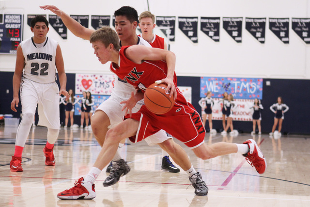 Lincoln County's Mike Wood drives past The Meadows forward Michael Jin during their game Saturday at The Meadows. Wood scored 25 points as Lincoln County won 81-72 in overtime. (Sam Morris/Las Veg ...