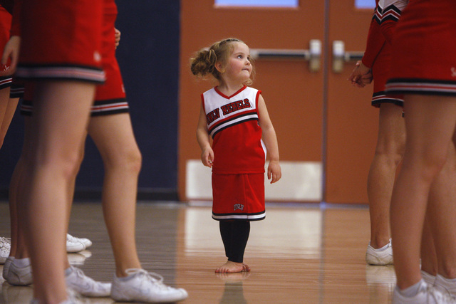 Alexis Harr looks for guidance from the Lincoln County cheerleaders while Lincoln County plays The Meadows during their game Saturday, Jan. 31, 2015 at The Meadows. Lincoln County won 81-72  in ov ...