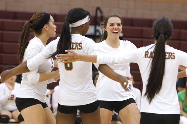 From left, Mojave girls volleyball players RayEna Rael, Kristina Gomez, Shyanne Orton and Leilani Limtiaco celebrate a point during their match against Faith Lutheran. (Sam Morris/Las Vegas Review ...