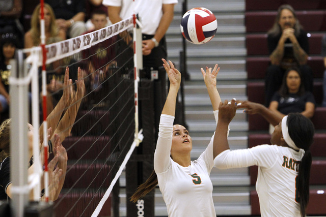Mojave Girls Volleyball player RayEna Rael sets the ball for Kristina Gomez during their game against Faith Lutheran Thursday, Sept. 18, 2014 at Faith Lutheran in Las Vegas. (Sam Morris/Las Vegas  ...