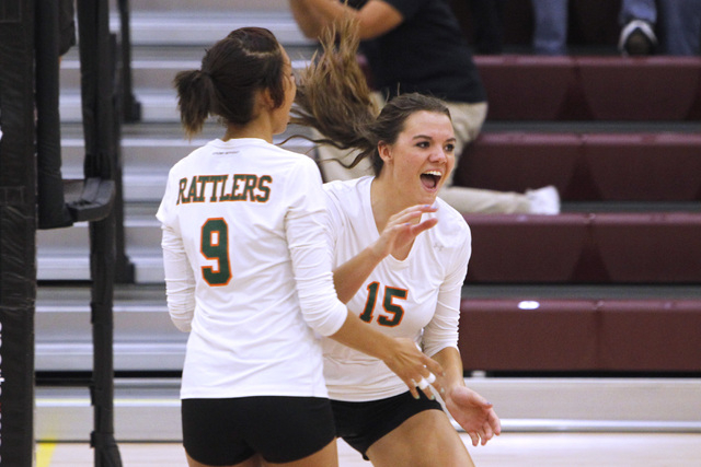 Mojave girls volleyball players Allison O'Neill, left, and Shyanne Orton celebrate a point during their match against Faith Lutheran. (Sam Morris/Las Vegas Review-Journal)