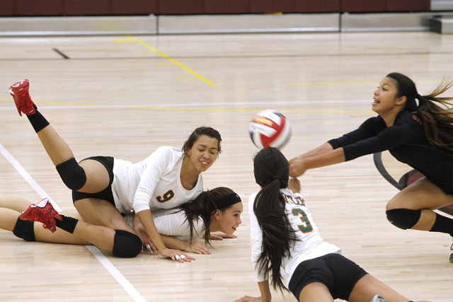 From left, Mojave girls volleyball players Allison O'Neill, RayEna Rael and Leilani Limtiaco crash to the floor as Sierra Cummings dives in to dig the ball during their match against Faith Luthera ...