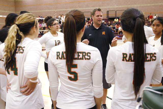 Mojave girls volleyball coach Erik Davis talks to his players between sets against Faith Lutheran. (Sam Morris/Las Vegas Review-Journal)