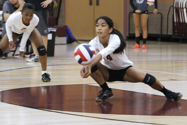 Mojave girls volleyball player Carissa Limtiaco digs a ball during their match against Faith Lutheran. (Sam Morris/Las Vegas Review-Journal)