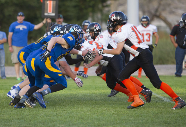 Pahranagat Valley Panthers and Wells, Nevada players face-off during the season opening eight-man high school football game in Alamo, Nevada on Friday, Aug. 26, 2016.  (Richard Brian/Las Vegas Rev ...