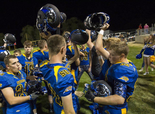 Pahranagat Valley Panthers gather for a victory chant after defeating Wells, Nevada following the season opening eight-man high school football game in Alamo, Nevada on Friday, Aug. 26, 2016.  (Ri ...
