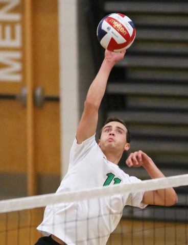 Palo Verde's Michael Simister spikes the ball during a volleyball game against Green Valley at Palo Verde High School Monday, April 20, 2015, in Las Vegas. Palo Verde won 3-2. (Ronda Churchill/Las ...