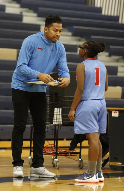 Western High School girls basketball coach Phillip Payne talks with guard Millani Johnson (1) during their game against Shadow Ridge Highs School in Las Vegas, Friday, Jan. 13, 2017. Payne is a fo ...