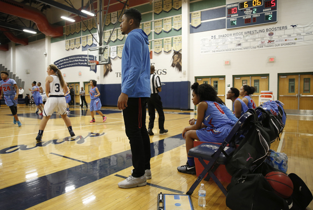 Western High School girls basketball coach Phillip Payne watches action on the court during their game against Shadow Ridge High School in Las Vegas, Friday, Jan. 13, 2017. Payne is a former UNLV  ...