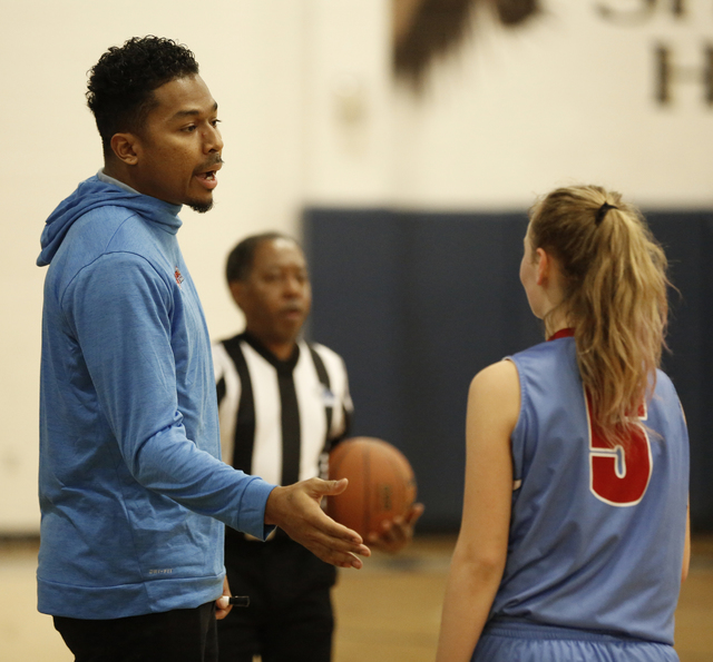 Western High School girls basketball coach Phillip Payne talks with guard Adrianna Jones (5) during their game against Shadow Ridge Highs School in Las Vegas, Friday, Jan. 13, 2017. Payne is a for ...