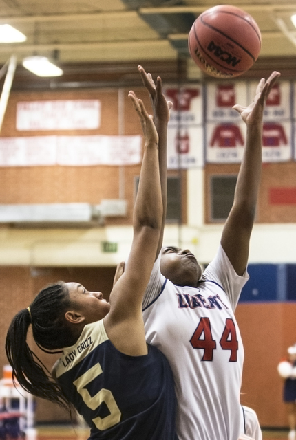 Liberty's Dre'una Edwards (44) grabs a rebound over Spring Valley's Bria Hardin-Davidson (5) on Tuesday, Feb. 21, 2017, at Valley High School, in Las Vegas. (Benjamin Hager/Las Vegas Review-Journa ...