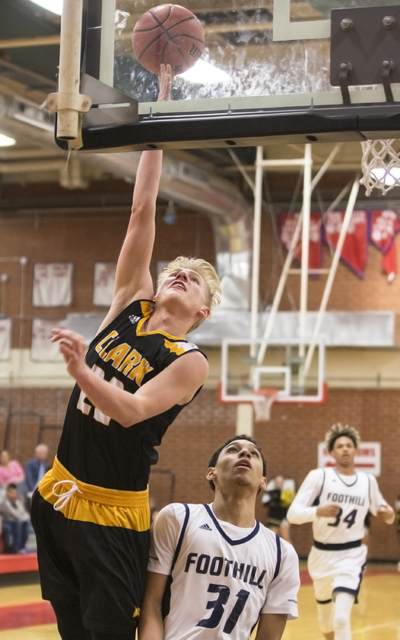 Clark's Trey Woodbury (22) slices to the basket past  Foothill's Marvin Coleman (31) on Tuesday, Feb. 21, 2017, at Valley High School, in Las Vegas. (Benjamin Hager/Las Vegas Review-Journal) @benj ...