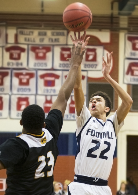 Foothill's Jace Roquemore (22) shoots a contested three point shot over Clark's Antwon Jackson (23) on Tuesday, Feb. 21, 2017, at Valley High School, in Las Vegas. (Benjamin Hager/Las Vegas Review ...