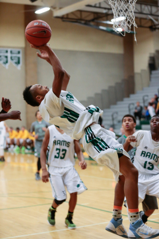Rancho High School's David McKeever (1) maneuvers up and around to take a shot in a game with Green Valley earlier this season. McKeever averages 15.8 points and has the Rams eyeing their first pl ...