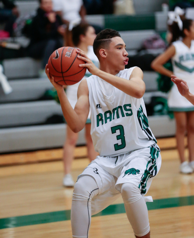 Rancho High School's Chrys Jackson (3) stops to pass the ball to his teammate during a basketball game with Green Valley. Jackson and the Rams are off to a 10-7 start after going 6-20 last season. ...