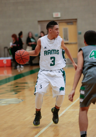 Rancho High School's Chrys Jackson (3) moves the ball up the court during a basketball game with Green Valley. Jackson and the Rams are looking to make their first playoff appearance since 2006. ( ...