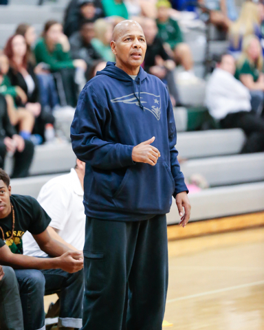 Rancho High School's Coach Ronald Childress watches his players on the court during a basketball game with Green Valley. Childress has gotten the Rams off to a 10-7 start after the Rams went 6-20  ...