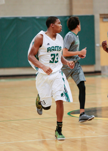 Rancho High School's Lamont Traylor (33) runs the court against Green Valley earlier this season. Traylor has given the Rams a strong inside presence and helped them to a 10-7 start after going 6- ...