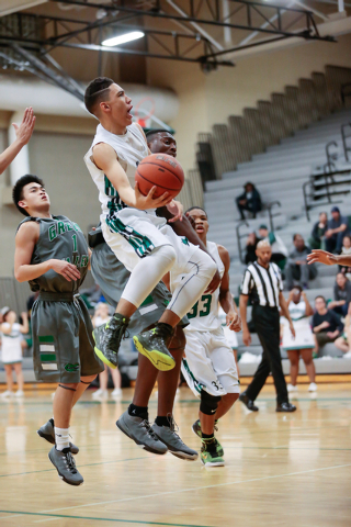 Rancho High School's Chrys Jackson (3) takes a shot against Green Valley earlier this season. Jackson averages 7.7 poins. (Donavon Lockett/Las Vegas Review-Journal)