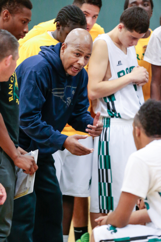 Rancho High School coach Ronald Childress talks with his players during a timeout during a game with Green Valley. Childress is trying to turn around a program that hasn't made the playoffs since  ...