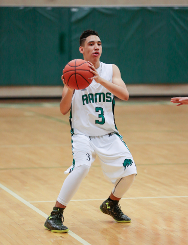 Rancho High School's Chrys Jackson (3) stops and looks for an open teammate against Green Valley earlier this season. (Donavon Lockett/Las Vegas Review-Journal)