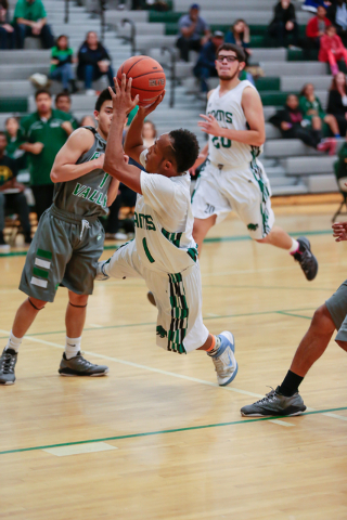 Rancho High School's David McKeever (1) takes an off-balance shot against Green Valley earlier this season. McKeever leads the Rams in scoring with an average of 15.8. (Donavon Lockett/Las Vegas R ...