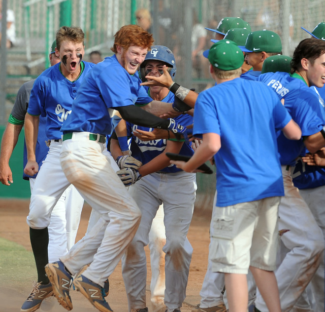 Green Valley's Keaton Smith, red hair, celebrates with his teammates after he hit a game-tying, three-run homer against Foothill in the Sunrise Region tournament on Friday. Smith's homer highlight ...