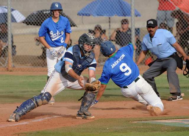 Green Valley's Ryan Jackson (9) scores the go-ahead run as Foothill catcher Zach Avery gets the late ball in the fifth inning on Friday. Green Valley scored eight runs in the fifth to erase a 6-0  ...