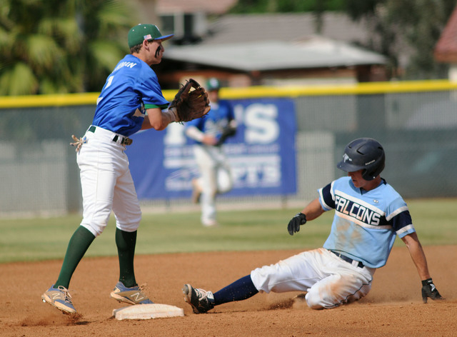 Foothill's Ryan Moyes slides safely into second base as Green Valley's Jarod Penniman waits for the ball in the Sunrise Region tournament on Friday. Green Valley won, 11-9. (Jerry Henkel/Las Vegas ...
