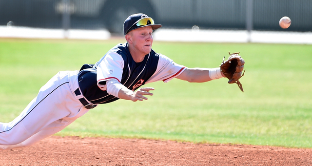 Coronado High School shortstop Jordan Dalrymple dives for the ball during a first round game in the Sunrise Region baseball tournament against Silverado at Silverado High School on Tuesday, May 5, ...