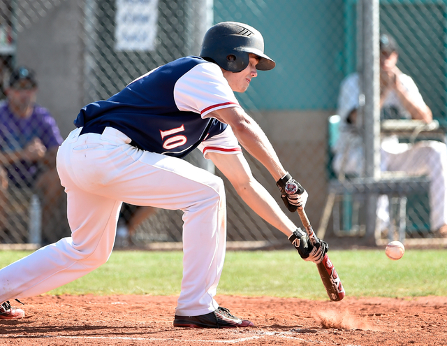 Coronado High School's Jacen Yergensen bunts the ball during a first round game in the Sunrise Region baseball tournament  against Silverado at Silverado High School on Tuesday, May 5, 2015, in He ...