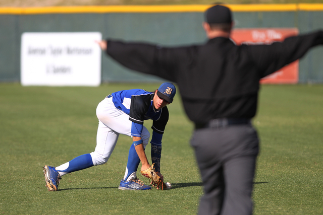 Basic's Cory Wills (2) drops a fly ball in the outfield in the second inning of their baseball game against Green Valley at Las Vegas High School in Las Vegas Thursday, May 7, 2015. Green Valley w ...