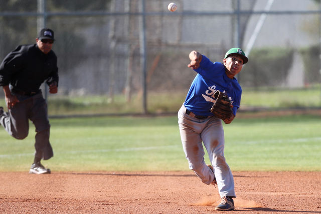 Green Valley's Jimmy Montiel (6) throws the ball to first base for an out in the second inning of their baseball game against Basic at Las Vegas High School in Las Vegas Thursday, May 7, 2015. Gre ...