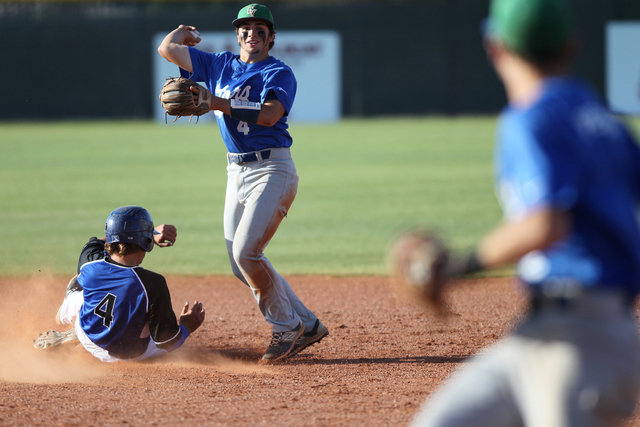 Green Valley's A.J. Amelburu (4) tags out Basic's David Hudleson (5) at second base in the fourth inning of their baseball game at Las Vegas High School in Las Vegas Thursday, May 7, 2015. Green V ...