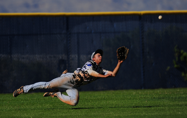 Shadow Ridge left fielder Bryson Barnes makes a diving catch to rob a Centennial batter of a base hit in the fifth inning of their prep baseball game at Centennial High School in Las Vegas Wednesd ...