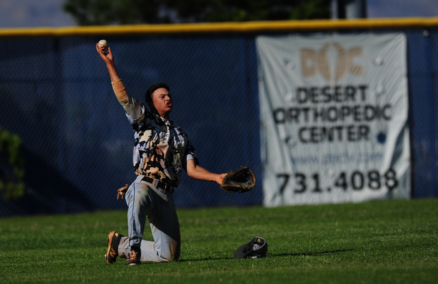 Shadow Ridge left fielder Bryson Barnes shows the ball to the umpire after making a diving catch to rob a Centennial batter of a base hit in the fifth inning of their prep baseball game at Centenn ...
