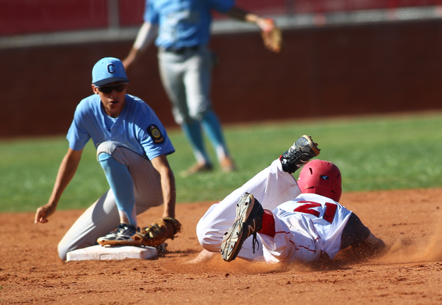 Centennial's Jacob Horton, left, looks to tag out Arbor View's Gabe Gonzales at second base during the Sunset Region baseball tournament on Wednesday. Centennial won, 4-2. (Chase Stevens/Las Vegas ...