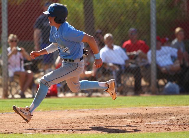 Centennial's Ricky Koplow scores a run against Arbor View during the Sunset Region baseball tournament on Wednesday. Centennial won, 4-2. (Chase Stevens/Las Vegas Review-Journal)